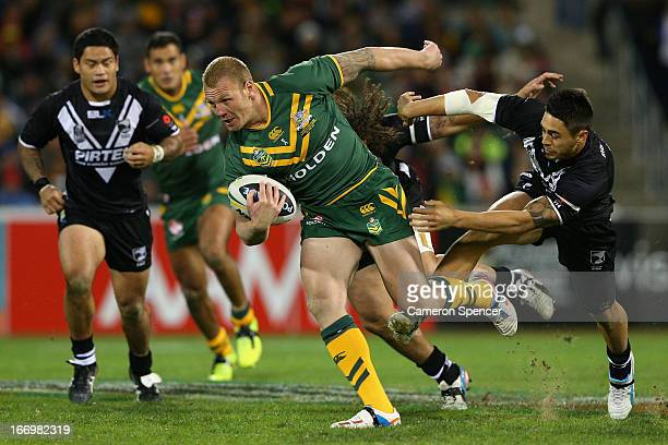 Luke Lewis of the Kangaroos makes a break during the ANZAC Test match between the Australian Kangaroos and the New Zealand Kiwis at Canberra Stadium...