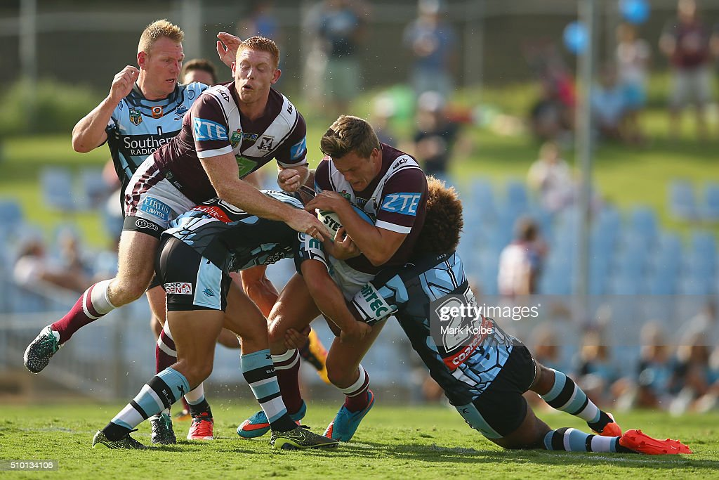 <a gi-track='captionPersonalityLinkClicked' href=/galleries/search?phrase=Luke+Lewis&family=editorial&specificpeople=243041 ng-click='$event.stopPropagation()'>Luke Lewis</a> of the Sharks and Tom Symonds of the Eagles collide as Liam Knight of the Eagles is tackled during the NRL Trial match between the Cronulla Sharks and the Manly Sea Eagles at Remondis Stadium on February 14, 2016 in Sydney, Australia.