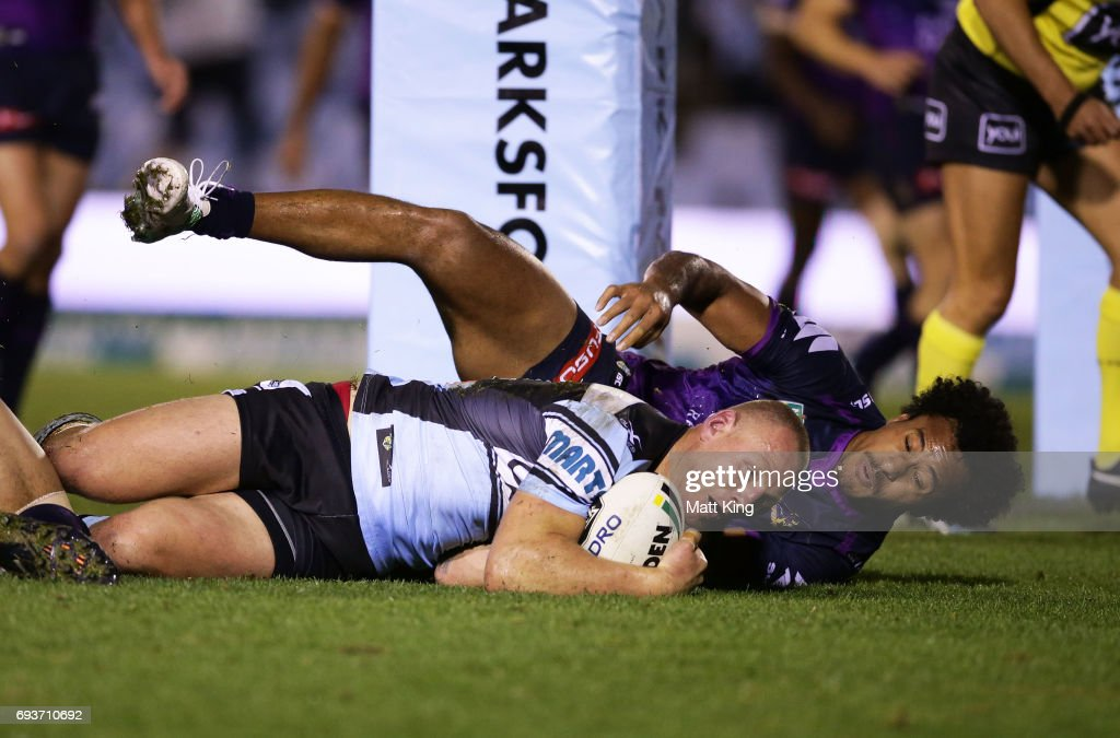Luke Lewis of the Sharks beats Felise Kaufusi of the Storm to score a try during the round 14 NRL match between the Cronulla Sharks and the Melbourne Storm at Southern Cross Group Stadium on June 8, 2017 in Sydney, Australia.