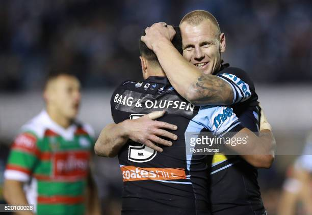 Luke Lewis of the Sharks celebrates after Gerard Beale of the Sharks scored a tryduring the round 20 NRL match between the Cronulla Sharks and the...