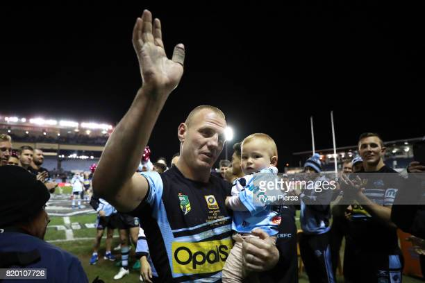 Luke Lewis of the Sharks celebrates after his 300th NRL match during the round 20 NRL match between the Cronulla Sharks and the South Sydney...