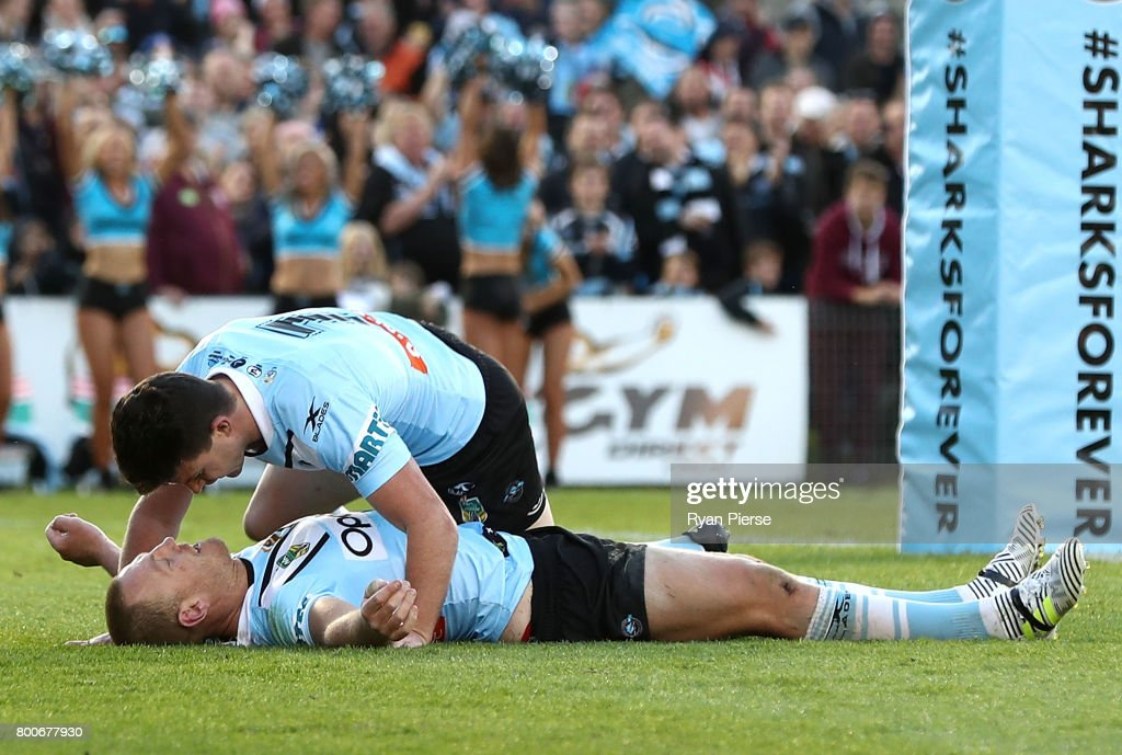 Luke Lewis of the Sharks is congratulated by Chad Townsend of the Sharks after scoring a try during the round 16 NRL match between the Cronulla Sharks and the Manly Sea Eagles at Southern Cross Group Stadium on June 25, 2017 in Sydney, Australia.
