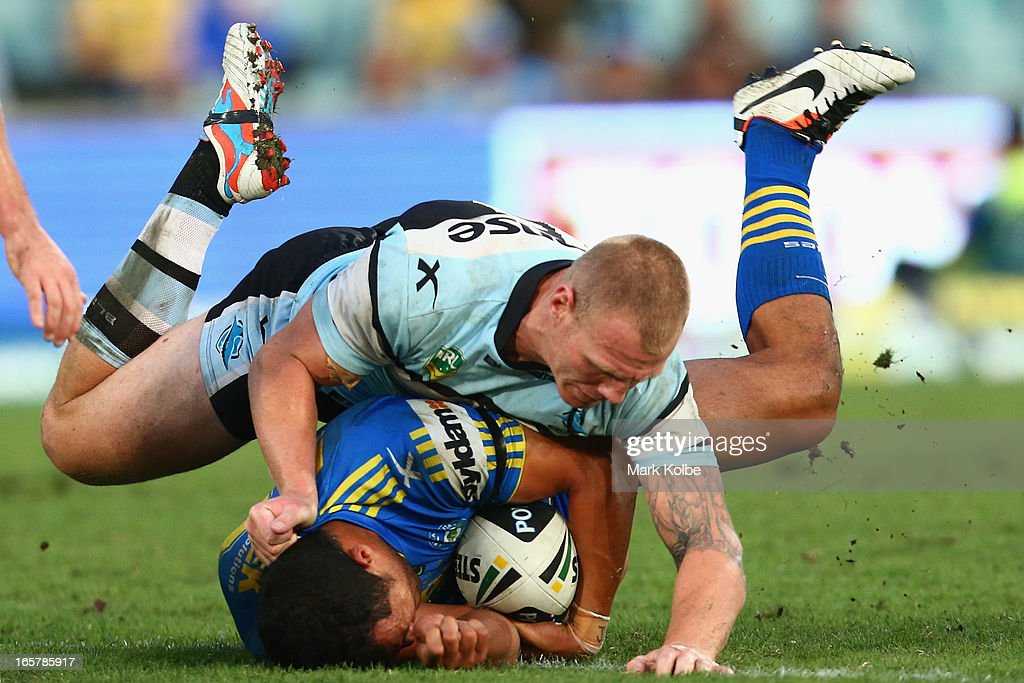 <a gi-track='captionPersonalityLinkClicked' href=/galleries/search?phrase=Luke+Lewis&family=editorial&specificpeople=243041 ng-click='$event.stopPropagation()'>Luke Lewis</a> of the Sharks tackles Kelepi Tanginoa of the Eels during the round five NRL match between the Parramatta Eels and the Cronulla Sharks at Parramatta Stadium on April 6, 2013 in Sydney, Australia.