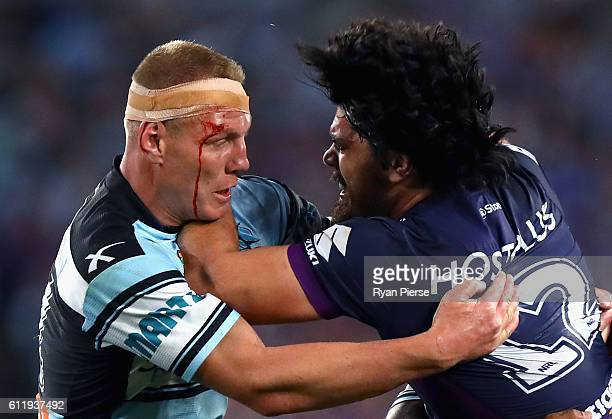 Luke Lewis of the Sharks tackles Tohu Harris of the Storm during the 2016 NRL Grand Final match between the Cronulla Sutherland Sharks and the...
