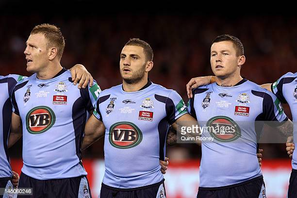 Luke Lewis Robbie Farah and Todd Carney of the Blues sing the national anthem before game one of the ARL State of Origin series between the...