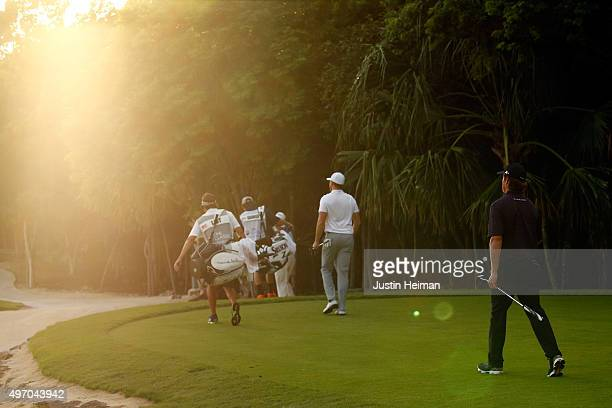 Luke List and Derek Fathauer of the United States walk off the 8th green during the second round of the OHL Classic at the Mayakoba El Camaleon Golf...