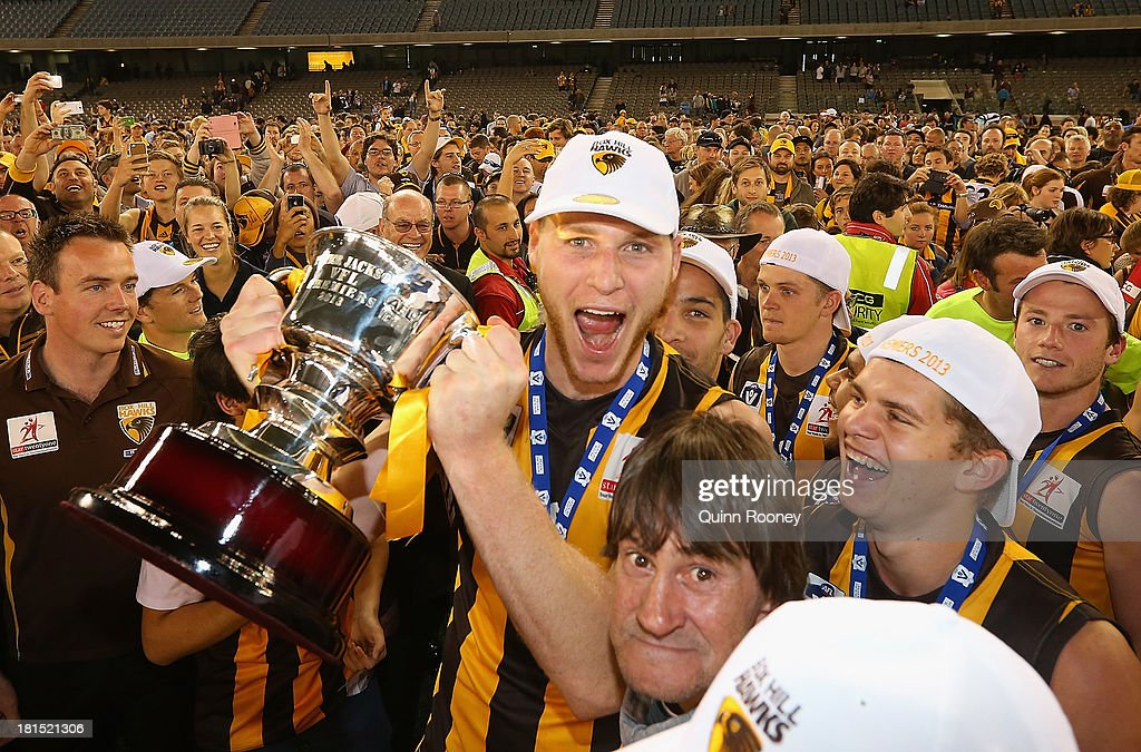 Luke Lowden of the Hawks celebrates with the Premiership Cup after winning the VFL Grand Final match between the Box Hill Hawks and the Geelong Cats at Etihad Stadium on September 22, 2013 in Melbourne, Australia.