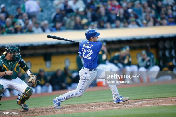 Luke Maile of the Toronto Blue Jays bats during the game against the Oakland Athletics at the Oakland Alameda Coliseum on June 6 2017 in Oakland...