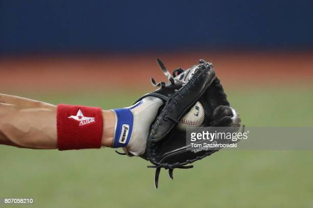 Luke Maile of the Toronto Blue Jays frames a pitch as he catches in the ninth inning during MLB game action against the Boston Red Sox at Rogers...