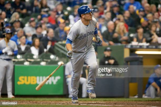 Luke Maile of the Toronto Blue Jays hits a sacrifice fly in the fifth inning against the Milwaukee Brewers at Miller Park on May 24 2017 in Milwaukee...
