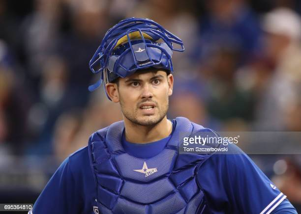 Luke Maile of the Toronto Blue Jays looks on with his mask off during MLB game action against the New York Yankees at Rogers Centre on June 1 2017 in...