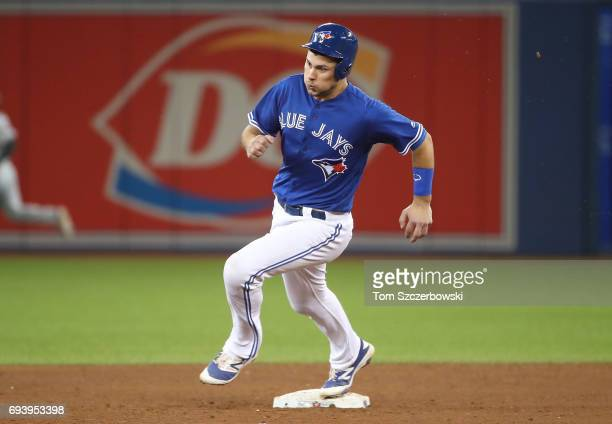 Luke Maile of the Toronto Blue Jays runs from first base to third base as he advances on a single by Devon Travis in the fifth inning during MLB game...