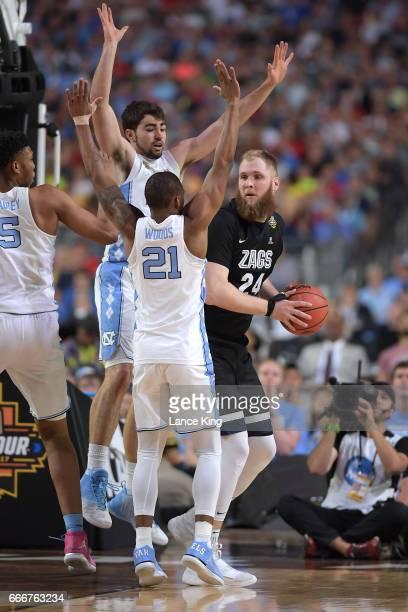 Luke Maye and Seventh Woods of the North Carolina Tar Heels defend Przemek Karnowski of the Gonzaga Bulldogs during the 2017 NCAA Men's Final Four...