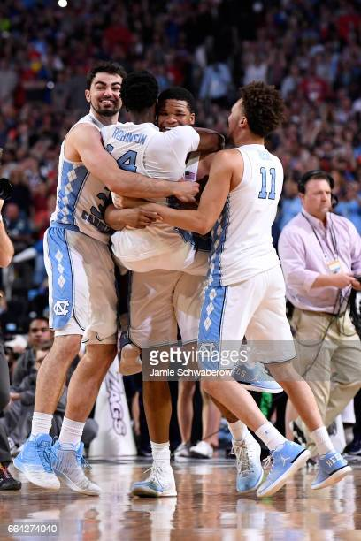 Luke Maye Brandon Robinson Shea Rush and Kennedy Meeks of the North Carolina Tar Heels embrace after time expires during the 2017 NCAA Men's Final...