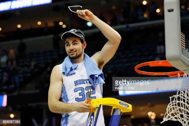 Luke Maye of the North Carolina Tar Heels cuts down the net after making the game winning shot and defeating the Kentucky Wildcats during the 2017...