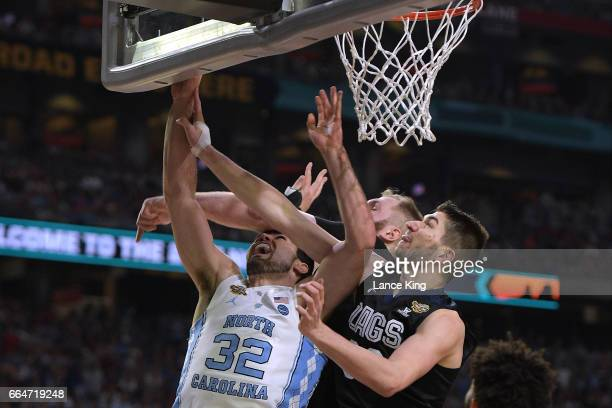 Luke Maye of the North Carolina Tar Heels puts up a shot against Przemek Karnowski and Killian Tillie of the Gonzaga Bulldogs during the 2017 NCAA...