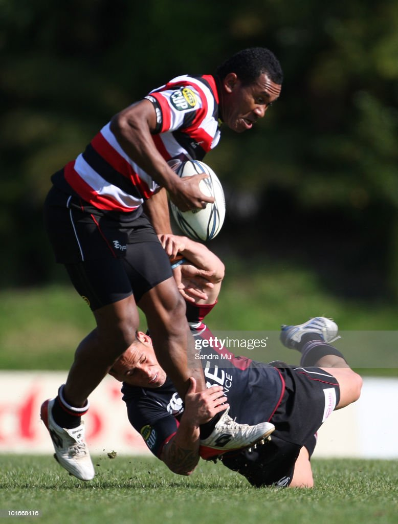 Luke McAlister of North Harbour swings off David Raikuna of Counties in a tackle during the round 10 ITM Cup match between Counties Manukau and North Harbour at Bayer Growers Stadium on October 3, 2010 in Pukekohe, New Zealand.
