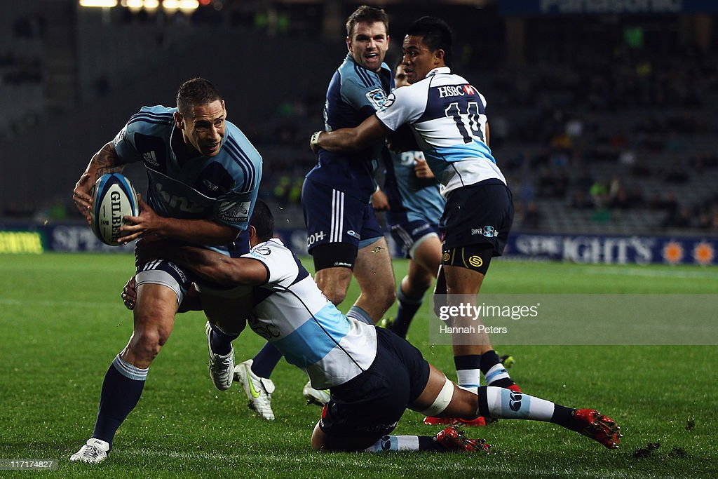 Luke McAlister of the Blues looks to offload the ball during the Super Rugby qualifier match between the Blues and the Waratahs at Eden Park on June 24, 2011 in Auckland, New Zealand.