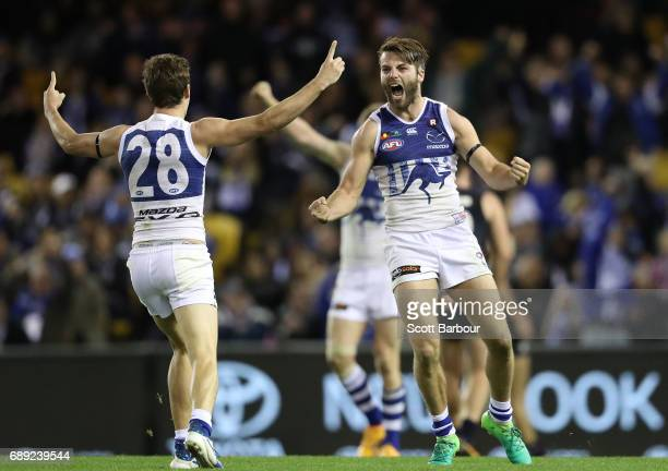 Luke McDonald of the Kangaroos celebrates after kicking a goal during the round 10 AFL match between the Carlton Blues and the North Melbourne...