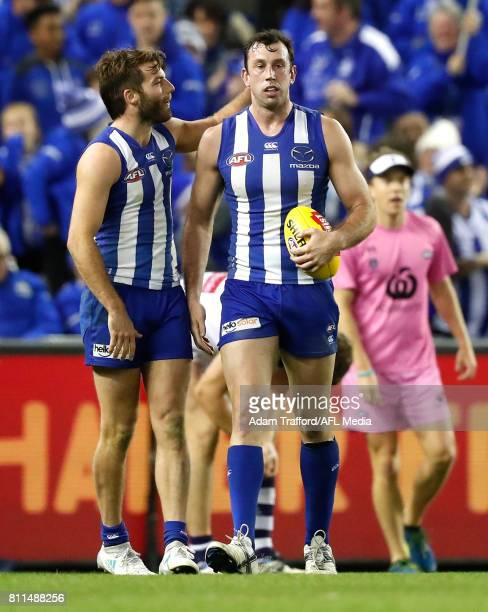 Luke McDonald of the Kangaroos encourages Todd Goldstein of the Kangaroos as he lines up to kick to win the game during the 2017 AFL round 16 match...