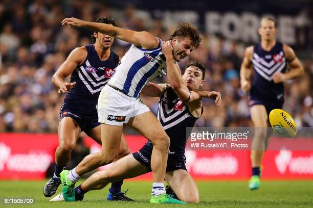 Luke McDonald of the Kangaroos is tackled high by Lachie Neale of the Dockers during the round five AFL match between the Fremantle Dockers and the...