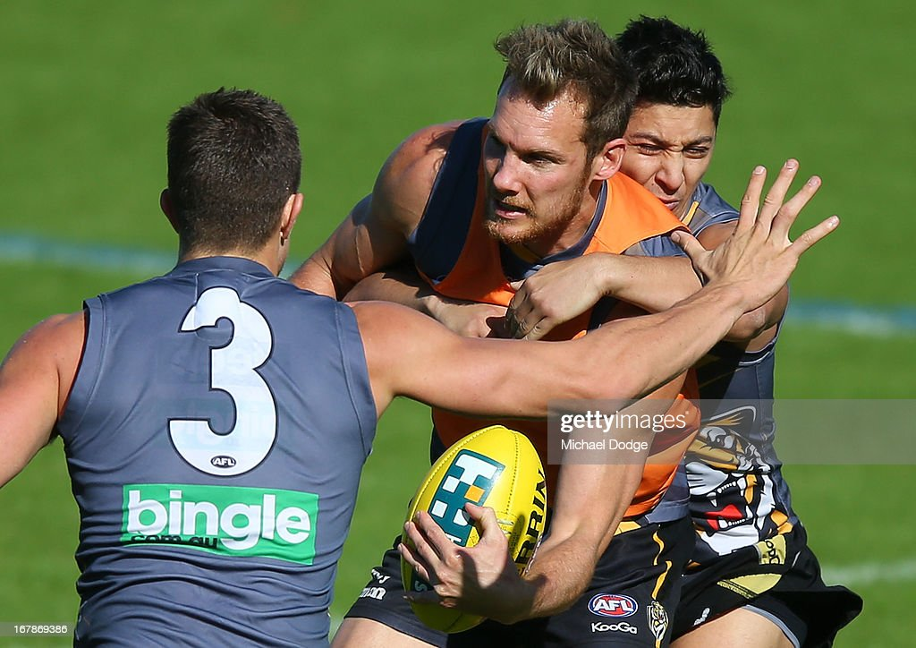 Luke McGuane gets tackled by Robin Nahas during a Richmond Tigers AFL training session at ME Bank Centre on May 2, 2013 in Melbourne, Australia.