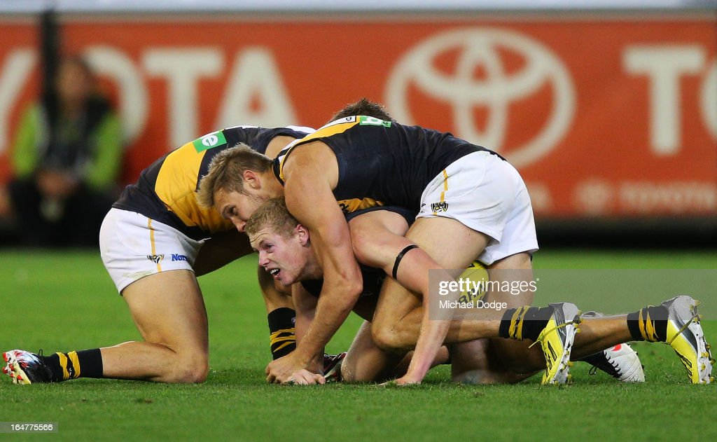 Luke McGuane of the Tigers was awarded a free kick after this match saving tackle on Jamie Bootsma of the Blues during the round one AFL match between the Carlton Blues and the Richmond Tigers at Melbourne Cricket Ground on March 28, 2013 in Melbourne, Australia.