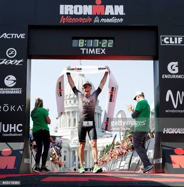 Luke McKenzie of Australia celebrates as he crosses the finish line in first place to win the Ironman Madison on September 10 2017 in Madison...