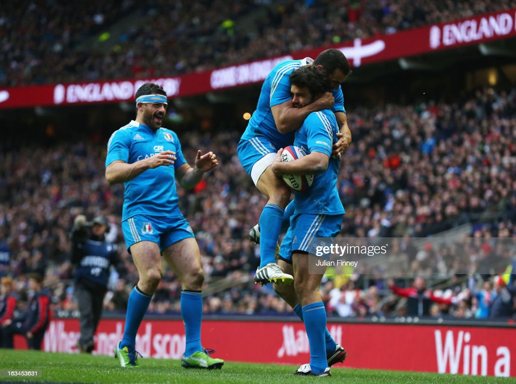 <a gi-track='captionPersonalityLinkClicked' href=/galleries/search?phrase=Luke+McLean&family=editorial&specificpeople=5700811 ng-click='$event.stopPropagation()'>Luke McLean</a> of Italy celebrates scoring their first try with <a gi-track='captionPersonalityLinkClicked' href=/galleries/search?phrase=Gonzalo+Canale&family=editorial&specificpeople=773548 ng-click='$event.stopPropagation()'>Gonzalo Canale</a> of Italy and <a gi-track='captionPersonalityLinkClicked' href=/galleries/search?phrase=Andrea+Masi&family=editorial&specificpeople=572361 ng-click='$event.stopPropagation()'>Andrea Masi</a> of Italy during the RBS Six Nations match England and Italy at Twickenham Stadium on March 10, 2013 in London, England.