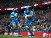 Luke McLean of Italy celebrates scoring their first try with Gonzalo Canale of Italy and Andrea Masi of Italy during the RBS Six Nations match...