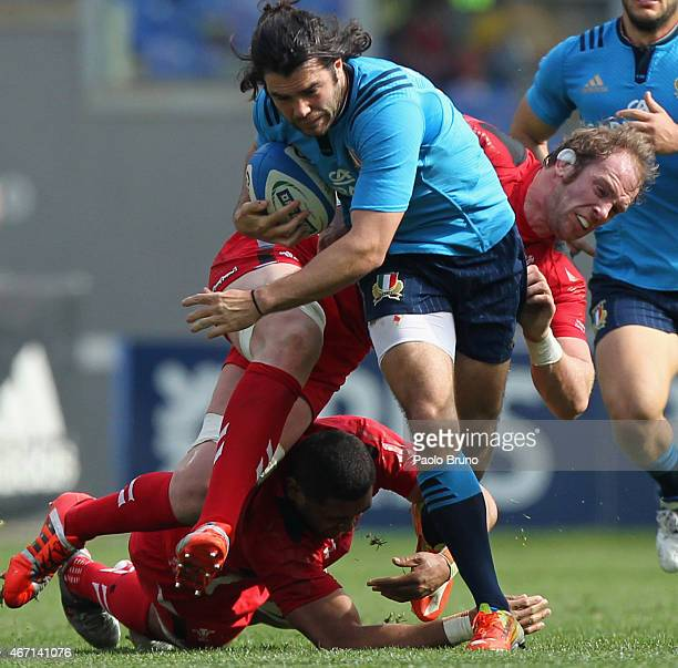Luke McLean of Italy is tackled by Alun Wyn Jones of Wales during the RBS Six Nations match between Italy and Wales at Stadio Olimpico on March 21...