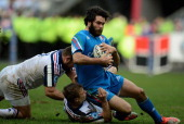 Luke McLean of Italy is tackled by Jules Plisson and Nicolas Mas of France during the RBS Six Nations match between France and Italy at Stade de...