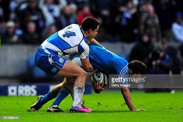 Luke McLean of Italy is tackled by Sean Maitland of Scotland during the RBS Six Nations match between Scotland and Italy at Murrayfield Stadium on...