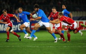 Luke McLean of Italy is tackled by Yury Kushnarev of Russia during the IRB 2011 Rugby World Cup Pool C match between Italy and Russia at Trafalgar...