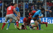 Luke Mclean of Italy is tackled during the international test match between Italy and Tonga at Mario Rigamonti Stadium on November 10 2012 in Brescia...
