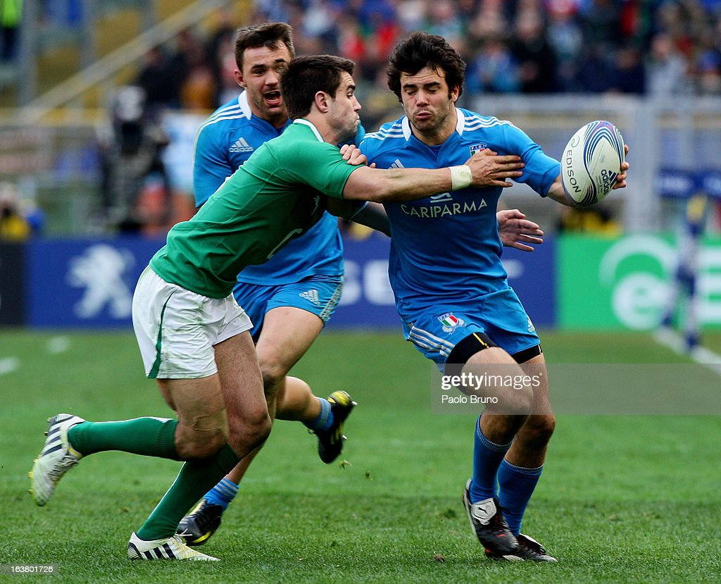 <a gi-track='captionPersonalityLinkClicked' href=/galleries/search?phrase=Luke+McLean&family=editorial&specificpeople=5700811 ng-click='$event.stopPropagation()'>Luke McLean</a> of Italy is tackled during the RBS Six Nations match between Italy and Ireland at Stadio Olimpico on March 16, 2013 in Rome, Italy.