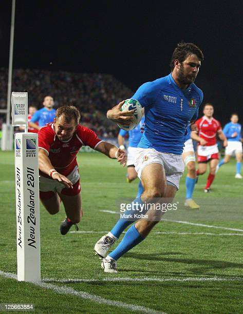 Luke McLean of Italy scores their seventh try during the IRB 2011 Rugby World Cup Pool C match between Italy and Russia at Trafalgar Park on...