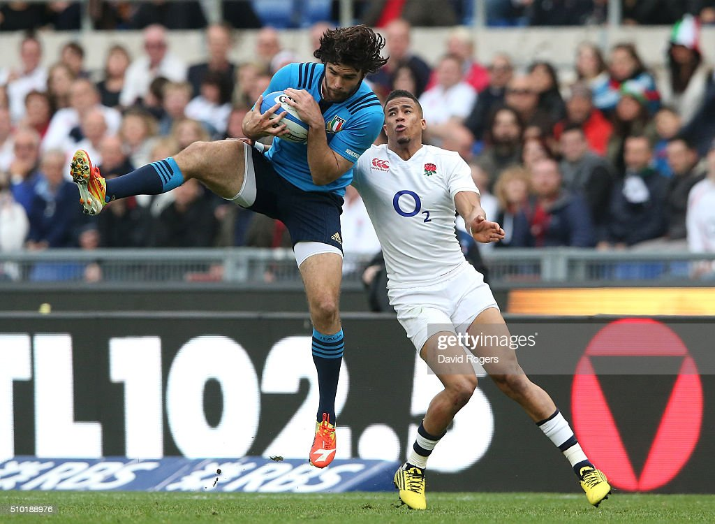 <a gi-track='captionPersonalityLinkClicked' href=/galleries/search?phrase=Luke+McLean&family=editorial&specificpeople=5700811 ng-click='$event.stopPropagation()'>Luke McLean</a> of Italy takes a high ball under pressure from Anthony Watson of England during the RBS Six Nations match between Italy and England at the Stadio Olimpico on February 14, 2016 in Rome, Italy.