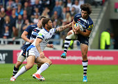 Luke McLean of Sale Sharks collects the ball under pressure from Matt Banahan of Bath Rugby during the Aviva Premiership match between Sale Sharks...