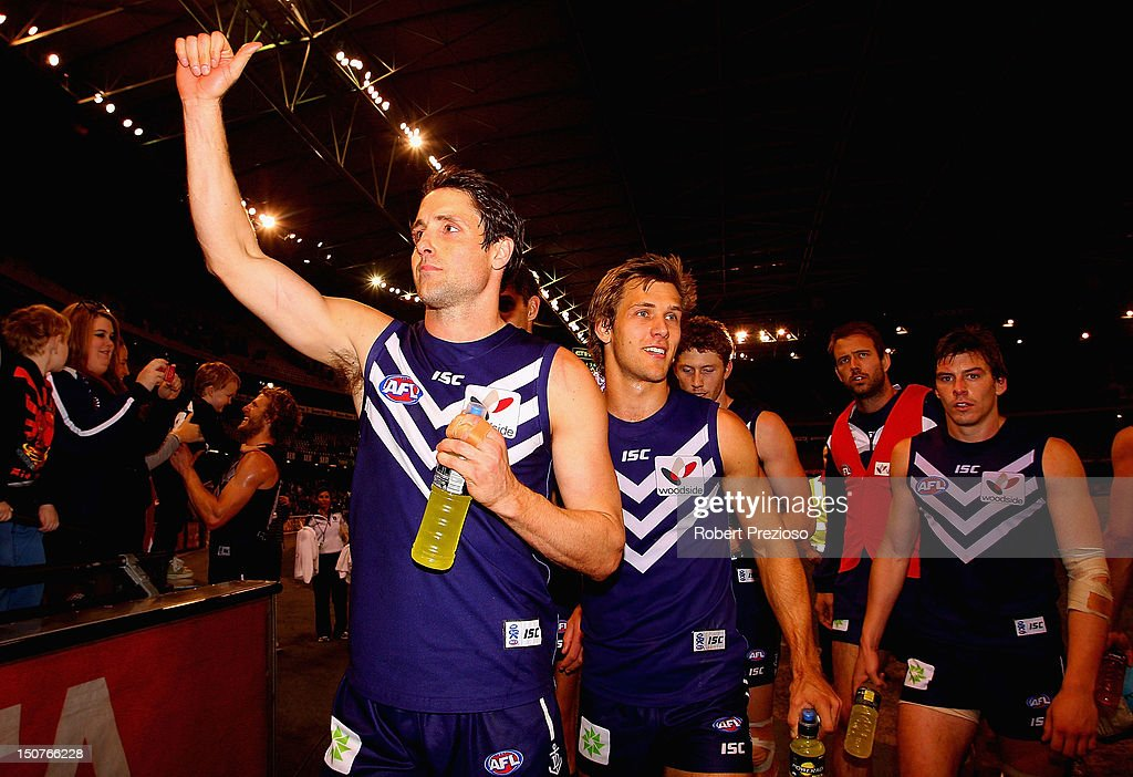 Luke McPharlin of the Dockers celebrates after the round 22 AFL match between the North Melbourne Kangaroos and the Fremantle Dockers at Etihad Stadium on August 26, 2012 in Melbourne, Australia.