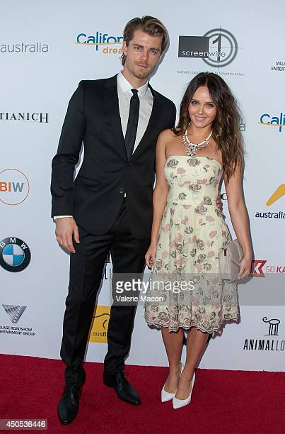 Luke Mitchell and wife Rebecca Breeds arrive at the Australians In Film's Heath Ledger Scholarship Dinner at SLS Hotel on June 12 2014 in Beverly...
