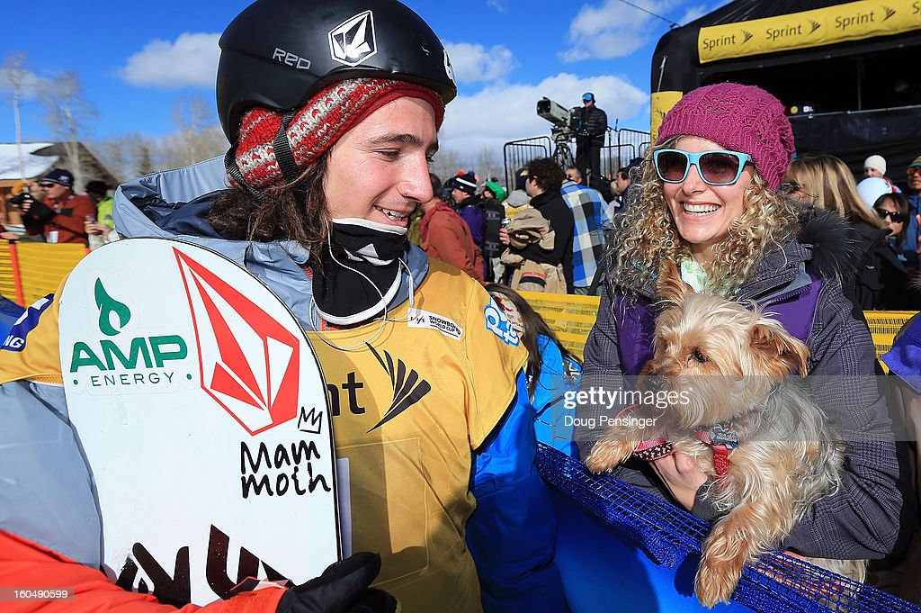 Luke Mitrani talks with <a gi-track='captionPersonalityLinkClicked' href=/galleries/search?phrase=Lindsey+Jacobellis&family=editorial&specificpeople=217703 ng-click='$event.stopPropagation()'>Lindsey Jacobellis</a> of the US Snowboardcross Team and her dog Gidget after Mitrani finished third in the FIS Snowboard Halfpipe World Cup at the Sprint U.S. Grand Prix at Park City Mountain on February 1, 2013 in Park City, Utah.