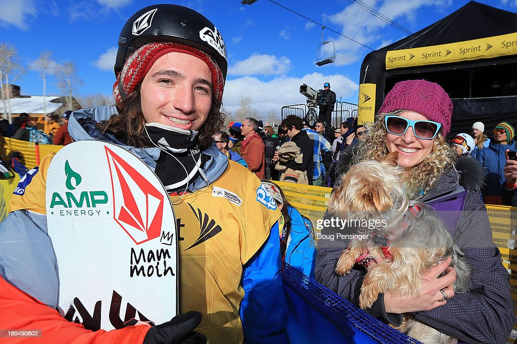 Luke Mitrani talks with Lindsey Jacobellis of the US Snowboardcross Team and her dog Gidget after Mitrani finished third in the FIS Snowboard Halfpipe World Cup at the Sprint U.S. Grand Prix at Park City Mountain on February 1, 2013 in Park City, Utah.