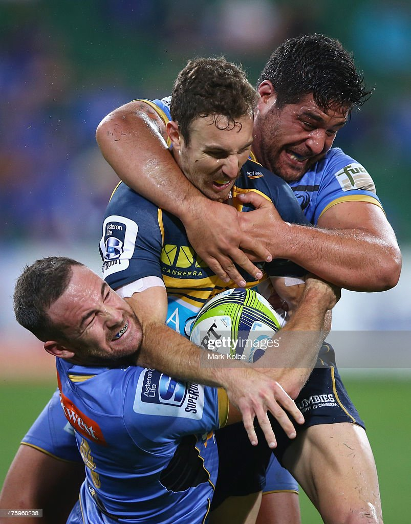 Luke Morahan and Pekahou Cowan (R)of the Force tackle <a gi-track='captionPersonalityLinkClicked' href=/galleries/search?phrase=Nic+White+-+Rugby+Player&family=editorial&specificpeople=10977486 ng-click='$event.stopPropagation()'>Nic White</a> of the Brumbies during the round 17 Super Rugby match between the Western Force and the Brumbies at nib Stadium on June 5, 2015 in Perth, Australia.