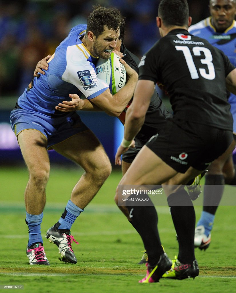 Luke Morahan (L) from Western Force attempts to break a tackle during the Super Rugby match between Australias Western Force and South Africas Bulls in Perth on April 29, 2016. --IMAGE RESTRICTED TO EDITORIAL USE NO COMMERCIAL USE-- / AFP / Greg Wood