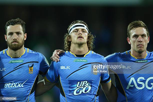 Luke Morahan Nick Cummins and Dane HaylettPetty of the Force observe a moment of silence to remember the late Jerry Collins during the round 17 Super...