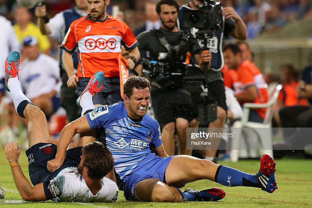 Luke Morahan of the Force grabs left his hamstring after tackling <a gi-track='captionPersonalityLinkClicked' href=/galleries/search?phrase=Rob+Horne&family=editorial&specificpeople=5127758 ng-click='$event.stopPropagation()'>Rob Horne</a> of the Waratahs during the round nine Super Rugby match between the Force and the Waratahs at nib Stadium on April 12, 2014 in Perth, Australia.