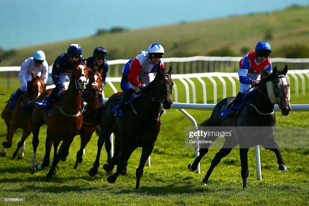 Luke Morris leads the field riding Pink Ribbon during the Sussex Cleaning & Care - Official Cleaning Partner Handicap Stakes at Brighton Racecourse on May 3, 2016 in Brighton, England.