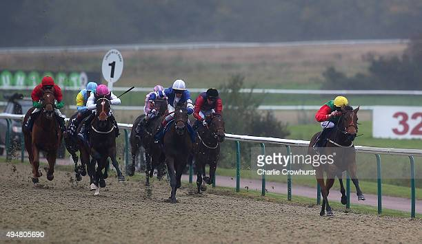 Luke Morris rides Our Joy to win The 32Red Casino/British Stallion Studs EBF Maiden Fillies' Stakes at Lingfield Park on October 29 2015 in Lingfield...
