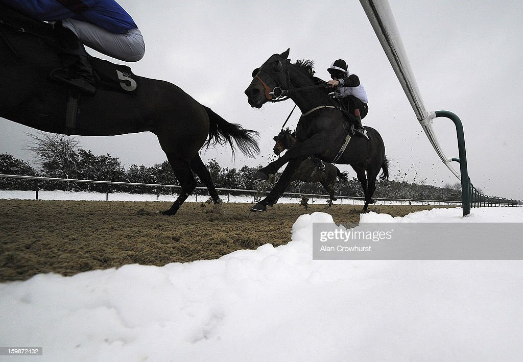 Luke Morris riding Where's Reiley turn into the straight to win The Stay At The Marriott Hotel Selling Stakes at Lingfield racecourse on January 22, 2013 in Lingfield, England.